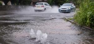 Burst water main causing flood damage